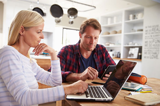 A married couple looking on the internet for a damage restoration company in boise idaho