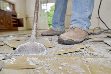 Master Restoration Idaho Boise man removing floor after water damage occured