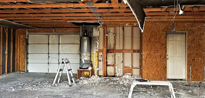 fire damage restoration in a garage after a water heater fire
