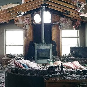 Burned out living room in boise that will need fire damage restoration services