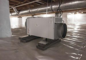 Dehumidifier in a home crawlspace after water damage restoration