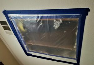 Water damage restoration needed on a homes roof that has leaked and soaked the ceiling drywall