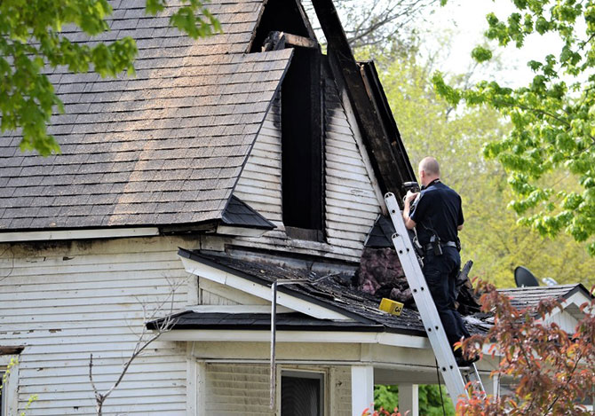 Fire inspector photographing house fire in Boise Idaho